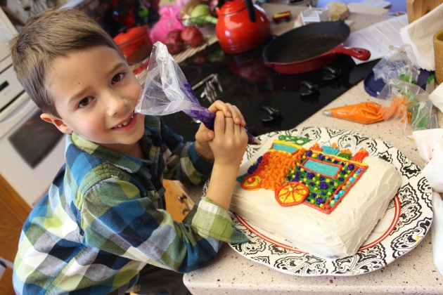 Decorating his own birthday cake