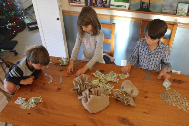 Counting up the money they earned from the boutique and their shepherds pouches. Total: $65! Praise God!